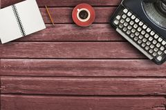 Typewriter,pencil,coffee and notebook and sheet  on wood table for creative writer nice. Typewriter,pencil,coffee and notebook and sheet  on wood table for Stock Image
