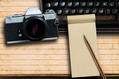 Typewriter, pencil, notepaper and old film camera stock images