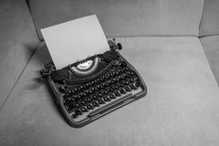 Typewriter ready for use with blank paper installed Stock Photo