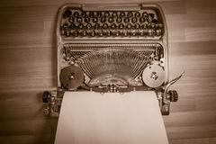 Typewriter ready for use with blank paper installed Stock Images