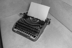 Typewriter ready for use with blank paper installed Royalty Free Stock Images