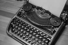 Typewriter ready for use with blank paper installed Royalty Free Stock Photo