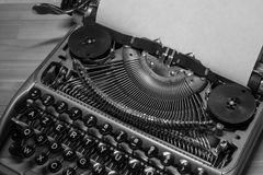 Typewriter ready for use with blank paper installed Royalty Free Stock Image
