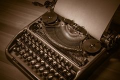Typewriter ready for use with blank paper installed Royalty Free Stock Photos