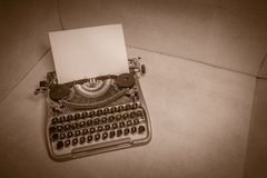 Typewriter ready for use with blank paper installed Stock Photos