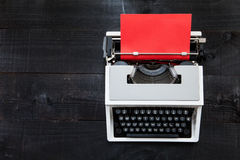 Typewriter and red paper Royalty Free Stock Images