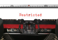 Typewriter Restricted. Restricted on an old typewriter in genuine red typescript Royalty Free Stock Images