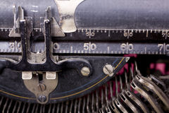 Typewriter Ruler. 1900-1920s antique typewriter close-up image. Showing the key bars, the ruler and all the accumulated dust and cobwebs and scratches over the Royalty Free Stock Images