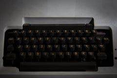 Typewriter Thai in the dark room Stock Photo
