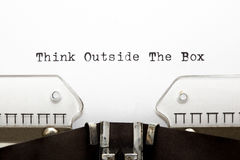 Typewriter THINK OUTSIDE THE BOX. Concept image about unconventional or different thinking. THINK OUTSIDE THE BOX written on an old typewriter Royalty Free Stock Photo