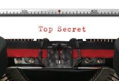 Typewriter Top Secret. Top Secret on an old typewriter in genuine typescript Royalty Free Stock Image