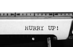 Typewriter. Typing text: hurry up ! Stock Photo