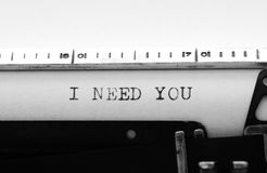 Typewriter. Typing text:  I need you Stock Images