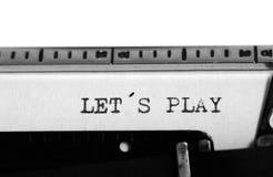 Typewriter. Typing text: let´s play Stock Image