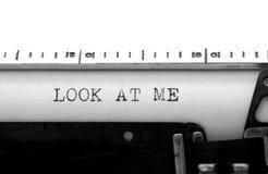 Typewriter. Typing text: look at me Stock Images