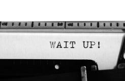 Typewriter. Typing text: Wait up! Royalty Free Stock Photo