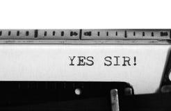 Typewriter. Typing text: Yes sir! Stock Photos