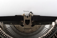 Typewriter typing the word update. Typewriter typing update, close up Royalty Free Stock Image