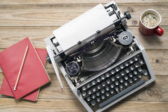 Typewriter. Vintage typewriter and a blank sheet of paper stock photography