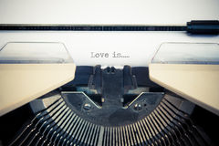 Typewriter with white paper Royalty Free Stock Images