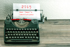 Typewriter with white paper page. New Years Resolutions. Typewriter with white paper page on wooden table. sample text 2015 New Years Resolutions. vintage style Stock Photography