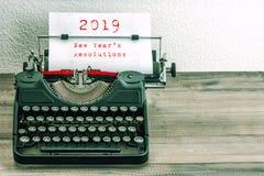 Typewriter white paper page New Years Resolutions 2019. Typewriter with white paper page on wooden table. 2019 New Years Resolutions. Vintage style toned picture royalty free stock photos