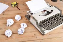 Typewriter on wood Stock Photography