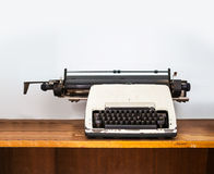 Typewriter on wooden table. Vintage filtered on typewriter on wooden table, content and writer concept Stock Image