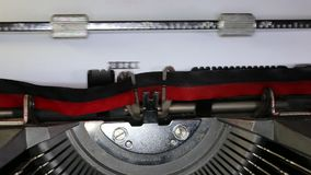 TYPEWRITER with written 2014 e 2015 in the paper. Old typewriter with written 2014 e 2015 with black ink in paper stock footage