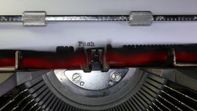 TYPEWRITER with written Fashion in the paper. Old typewriter with written Fashion with black ink in paper stock video footage