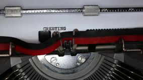 TYPEWRITER with written Greetings in the paper. Old typewriter with written Greetings with black ink in paper stock video footage