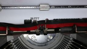 TYPEWRITER with written Happy 2015 in the paper. Old typewriter with written Happy 2015 with black ink in paper stock video footage