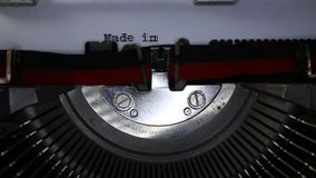 TYPEWRITER with written Made in Italy in the paper. Old typewriter with written Made in Italy with black ink in paper stock video footage