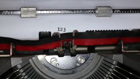 TYPEWRITER with written 123456789 in the paper. Old typewriter with written 123456789 with black ink in paper stock video footage
