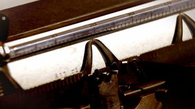 Typewriter and written text: All rigts reserved. Close up of typewriter and written text: All rigts reserved stock footage