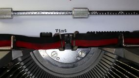 TYPEWRITER with written Vintage in the paper. Old typewriter with written Vintage with black ink in paper stock footage