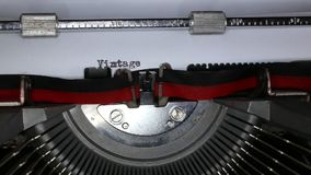 TYPEWRITER with written Vitange e Retro in the paper stock video footage