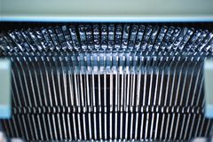 Typewriting machine detail. Metal letters forming a row. Empty copy space for Editor`s text Royalty Free Stock Photos