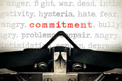 Typewritter with the word commitment. Typewriter written message with the word commitment Royalty Free Stock Images