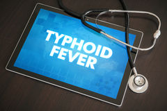 Typhoid fever (infectious disease) diagnosis medical concept. On tablet screen with stethoscope Stock Photography