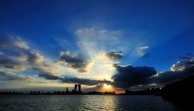 Scenery of SIP. After the typhoon beautiful scenery, the sun through the clouds to the lake, beautiful heaven light Stock Images