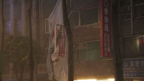 Typhoon Dujuan Banner blowing in typhoon with strong rain. NEW TAIPEI CITY, TAIWAN - SEPTEMBER 28, 2015: Heavy rain and wind in city during Typhoon Dujuan stock video