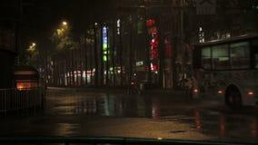 Typhoon Dujuan cars riding in heavy rain and wind. NEW TAIPEI CITY, TAIWAN - SEPTEMBER 28, 2015: Heavy rain and wind on city streets during Typhoon Dujuan. Cars stock video