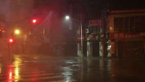 Typhoon Souledor, Taiwan, August 8, 2015. Heavy rain on dark street slow motion stock video