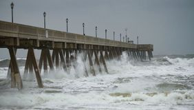 Typhoon Storm Surge. An incoming typhoon brings a strong storm surge upon a concrete pier Royalty Free Stock Photos