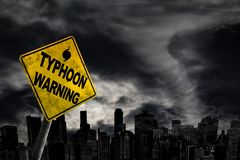 Typhoon Warning Sign Against City Silhouette With Copy Space Royalty Free Stock Images