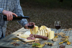 Typica Dinner in Sardinia. On the table in the wood pours drink the wine in the glass. Menu of sardinia royalty free stock photography