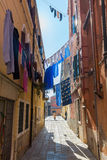 Typical alley with clotheslines in Venice, Italy Royalty Free Stock Photography