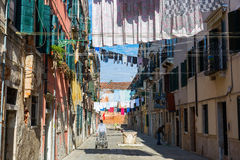 Typical alley with clotheslines in Venice, Italy Royalty Free Stock Photos