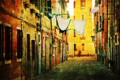 Typical alley with laundry lines in Venice with vintage texture Royalty Free Stock Images